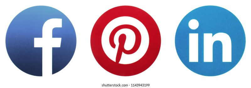 KIEV, UKRAINE - JUNE 25, 2018:  This is a photo collection of popular social media logos printed on paper: Facebook, LinkedIn, Pinterest