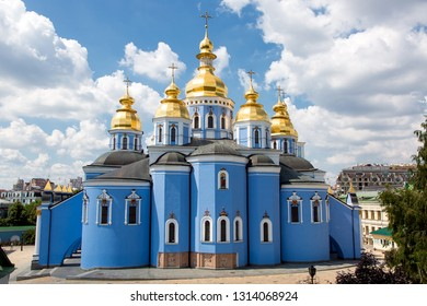 KIEV, UKRAINE - June 29, 2016: St. Michael's Golden-Domed Monastery is an architectural building of an orthodox blue church with golden domes with a cross.