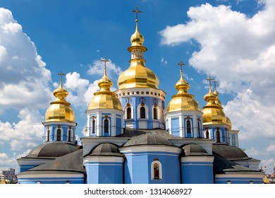 KIEV, UKRAINE - June 29, 2016: St. Michael's Golden-Domed Monastery еру roof is an architectural building of an orthodox blue church with golden domes with a cross.