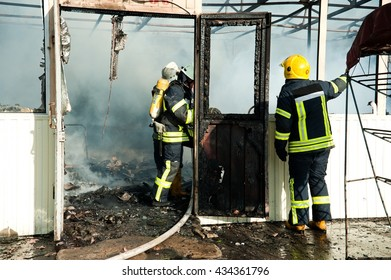 Kiev, Ukraine - June 3: Firefighters extinguish a large fire at Troyeschina market with water and fire extinguishers on June 3, 2016 in Kiev
