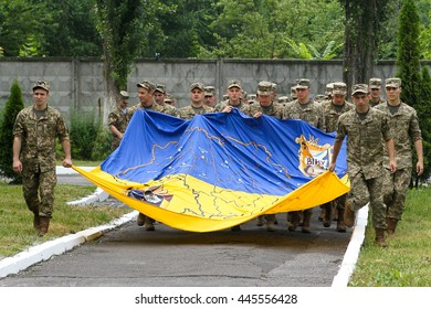 Kiev, Ukraine - June 30, 2016: Young officers carry the flag of Ukraine during the early 19 th issue of the officers in the Military Institute of Kyiv National Shevchenko University