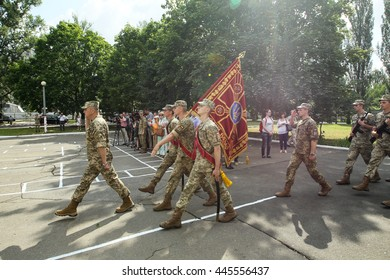 Kiev, Ukraine - June 30, 2016: Young officers carry flag with coat of arms of Ukraine during the of early 19 th issue of the officers in the Military Institute of Kyiv National Shevchenko University