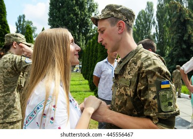 Kiev, Ukraine - June 30, 2016: She congratulates the her boyfriend during the early 19 th issue of the officers in the Military Institute of Kyiv National Shevchenko University