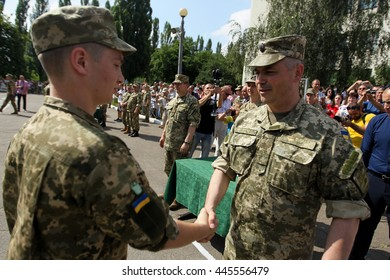 Kiev, Ukraine - June 30, 2016: A young officer receives diploma of the master during of early 19 th issue of the officers in the Military Institute of Kyiv National Shevchenko University