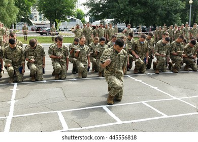 Kiev, Ukraine - June 30, 2016: Young officers a moment of silence for those killed in the zone of the ATO