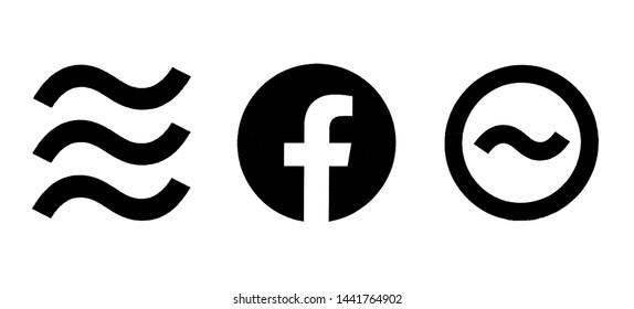 Kiev, Ukraine - June 30, 2019: Libra, Facebook and Calibra logos printed on paper. Libra Facebook cryptocurrency bitcoin cryptocurrency.