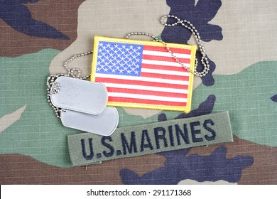KIEV, UKRAINE - June 6, 2015. US MARINES branch tape, flag patch and dog tags on woodland camouflage uniform