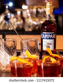 KIEV, UKRAINE - June 6, 2018: Bottle of Campari, an alcoholic liqueur containing herbs and fruit (including chinotto and cascarilla), invented in 1860 by Gaspare Campari in Novara, Italy.