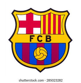 KIEV, UKRAINE - June 7, 2015: FC Barcelona logo printed on paper and placed on white background. Futbol Club Barcelona is a professional football club, based in Barcelona, Catalonia, Spain.