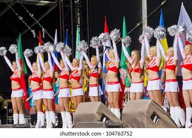 "KIEV, UKRAINE, JUNE 8, 2012: Euro 2012 main Football Fan zone opening on Main Street of Ukrainian capital - Khreshchatyk. Gymnastics and dance group ""Red Foxes"". Kiev, Ukraine, June 8, 2012"