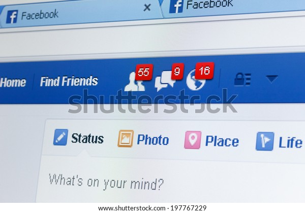 KIEV, UKRAINE - June 8: Facebook web page closeup with notifications of new friends request and messages, and blank status line, in Kiev, Ukraine, on June 8, 2014.