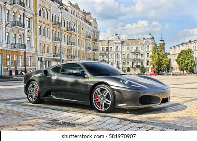 Kiev, Ukraine. June 9, 2013; Ferrari F430 in gray on the background of buildings. Editorial photo.