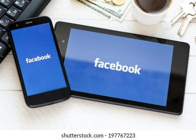 KIEV, UKRAINE - June 9: Facebook social network logo on new tablet and smartphone, in Kiev, Ukraine, on June 9, 2014.