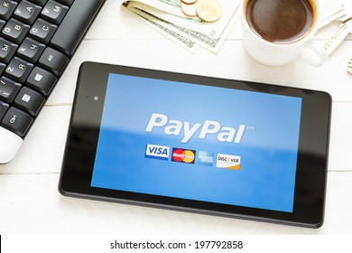 KIEV, UKRAINE - June 9: PayPal payment system logo on tablet, in Kiev, Ukraine, on June 9, 2014.