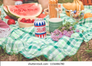 KIEV, UKRAINE - JUNE04 , 2018: Family at picnic drinks pepsi. Pepsi is a carbonated soft drink produced PepsiCo