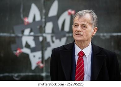 KIEV, UKRAINE - Mar. 21, 2015: Commissioner of the President of Ukraine and lider of the Crimean Tatars Mustafa Dzhemilev against installation dedicated to  the annexation of the Crimea