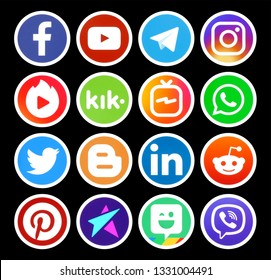 Kiev, Ukraine - March 01, 2019: Popular circle social media icons with white rim on black background printed on paper: Facebook, Twitter, Instagram, Pinterest, LinkedIn, Viber and others