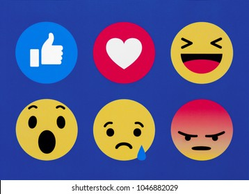 Kiev, Ukraine - March 03, 2016: New black Facebook like button 6 Empathetic Emoji reactions printed on paper. Facebook is a known social networking service.