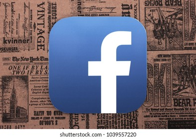 Kiev, Ukraine - March 06, 2018:  Facebook  icon printed on paper and placed on retro newspaper background