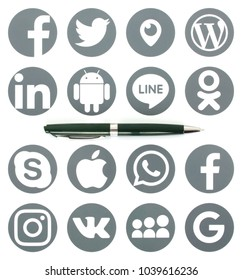 Kiev, Ukraine - MARCH 06, 2018: The pen lies on the collection of popular social media logos printed on paper: Facebook, Twitter, LinkedIn, Instagram, Line and other