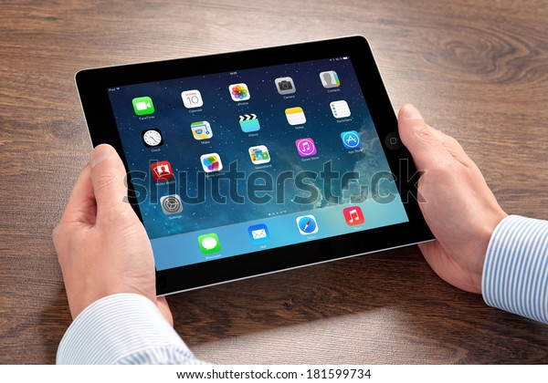 Kiev, Ukraine- March 10, 2014: Apple iPad displaying iOS 7.1 homescreen. iOS 7.1 operating system designed by Apple Inc. official output 10 March 2014. iPad is a tablet produced by Apple Inc.