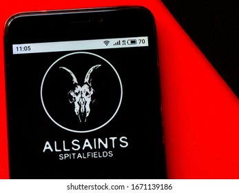 Kiev, Ukraine, March 12, 2020. Editorial illustrative. In this photo illustration the AllSaints logo is seen displayed on a smartphone