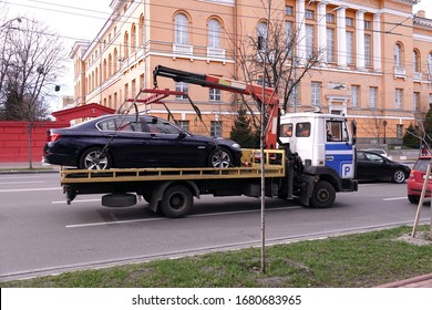 Kiev, Ukraine March 13, 2020: A tow truck cleans an improperly parked car near Taras Shevchenko University in Kiev
