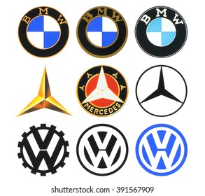 Kiev, Ukraine - March 16, 2016: Collection of retro car logos printed on white paper: Volkswagen, BMW and Mercedes
