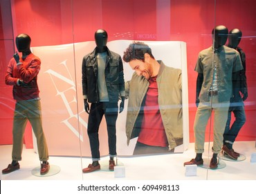KIEV, UKRAINE - MARCH 18, 2017: Boutique fashion mannequins in window of Marks and Spencer shop in Kiev. Marks and spencer is a  clothes brand.
