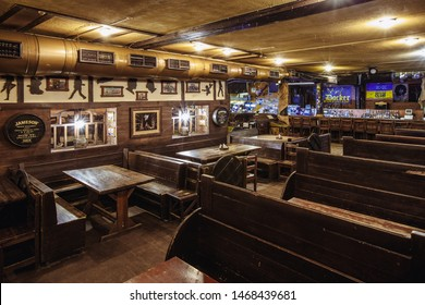 Kiev, Ukraine- March 19, 2018.  wooden chairs stand at large wooden tables in an Irish pub pub. nightclub party place for young people