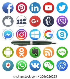 Kiev, Ukraine - MARCH 20, 2018: The pen lies on the collection of popular social media logos printed on paper: Facebook, Twitter, LinkedIn, Instagram, Line and other.