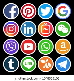 Kiev, Ukraine - March 20, 2019: Popular circle social media icons with white rim on black background printed on paper: Facebook, Twitter, Instagram, Pinterest, LinkedIn, Viber and others