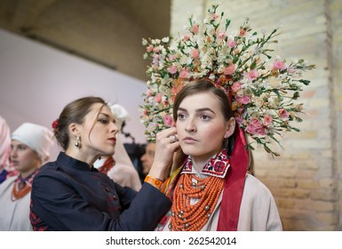 """KIEV, UKRAINE - MARCH, 21, 2015: Models on the backstage wears an authentic Ukrainian national costumes on the fourth day of the Ukrainian Fashion Week. This show is part of """"Beginnings"""" project."""