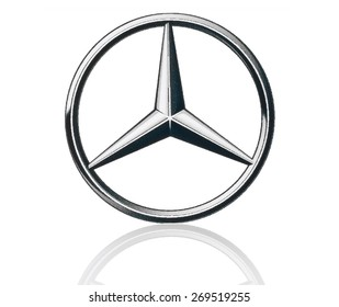 KIEV, UKRAINE - MARCH 21, 2015: Mercedes Benz logo printed on paper and placed on white background. Mercedes Benz is a German automobile manufacturer