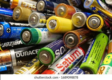 KIEV, UKRAINE, MARCH 21, 2020: Many multi-colored used batteries from various manufacturers