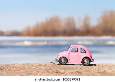 Kiev, Ukraine - March 25, 2018. Little red beetle car on nature background.  Summer vacation concept.