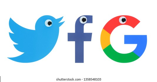 Kiev, Ukraine - March 26, 2019: Collection of popular social media logo: Facebook, Twitter and Google icons printed on white paper with eyes