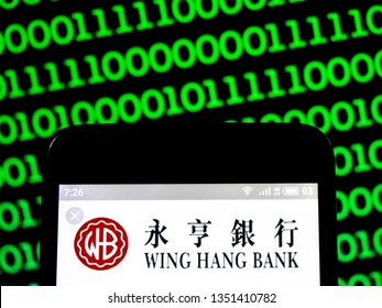 KIEV, UKRAINE - March 27, 2019: In this photo illustration a OCBC Wing Hang Bank logo seen displayed on a smart phone.