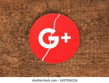 Kiev, Ukraine -  March 27, 2019: Google plus icon printed on paper, torn and put on old wooden background. Google is shutting down Google+, admits low consumer adoption.