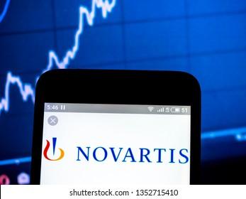 KIEV, UKRAINE - March 28, 2019: In this photo illustration a Novartis International AG  logo seen displayed on a smart phone.