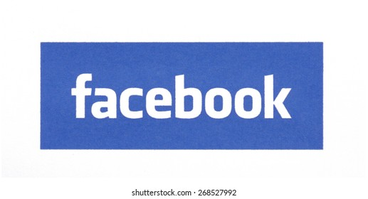 KIEV, UKRAINE - MARCH 31, 2015: Facebook logo printed on paper and placed on white background. Social network facebook sign on pc sign.