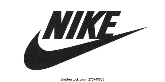 KIEV, UKRAINE - MARCH 31, 2015: Nike logo printed on paper. Nike, Inc. is an American multinational corporation that is engaged sales of footwear, apparel, equipment, accessories and services.