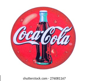 KIEV, UKRAINE - MARCH 31, 2015: Coca-Cola logo printed on paper and placed on white background. Coca-Cola is a carbonated soft drink sold in stores and restaurants throughout the world.