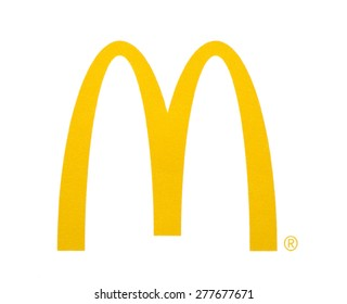 KIEV, UKRAINE - MARCH 31, 2015: McDonal's Logo printed on paper and placed on white background. The McDonald's Corporation is the world's largest chain of hamburger fast food restaurants.