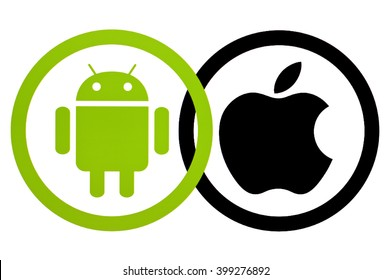 Kiev, Ukraine - March 31, 2016:  Android and Apple logotype on pc screen. Android - the operating system. Apple is an American corporation, that develops, and sells consumer electronics and computers.