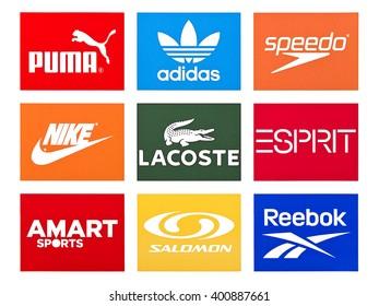 Kiev, Ukraine - March 31, 2016: Set of most popular logos of brands clothing printed on white paper: Adidas, Puma, Reebok, Speedo,  Lacoste,  Hennes & Mauritz, Salomon, Amart, Espirit.