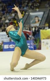KIEV, UKRAINE - MARCH 31: Dilnoza Abdusalimova, Uzbekistan performs floor exercise during International Tournament in Artistic Gymnastics Stella Zakharova Cup in Kiev, Ukraine on March 31, 2013