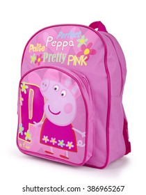Kiev, Ukraine - March 4, 2016:Bright pink children's backpack with Peppa pig on a white background. Pepa Pig is a cartoon character produced by the UK animations.