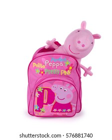 Kiev, Ukraine - March 4, 2016:Bright pink children's backpack with Peppa pig on a white background. Peppa Pig is a cartoon character produced by the UK animations.