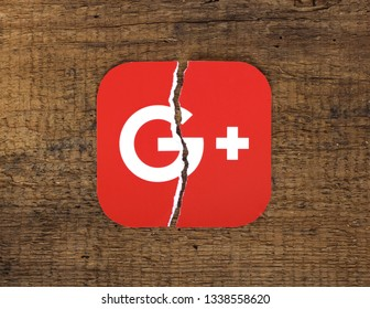 Kiev, Ukraine -  March 5, 2019  Google plus icon printed on paper, torn and put on old wooden background. Google is shutting down Google+.